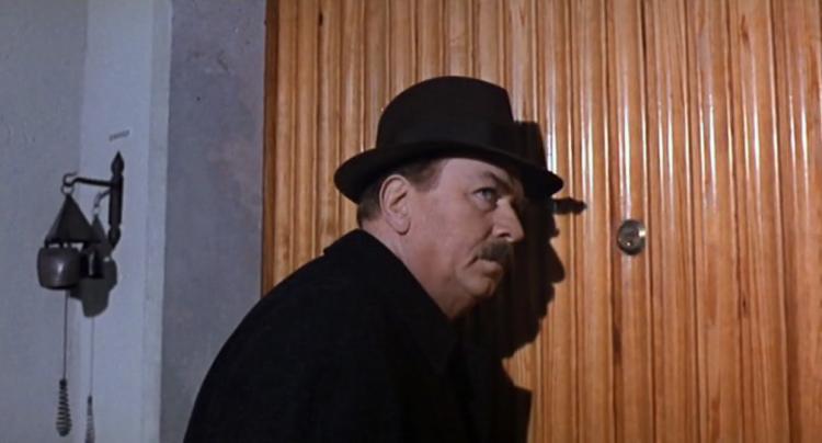 Maigret horcht an der Türe